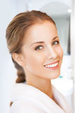 Beautiful woman in white bathrobe Stock Photos