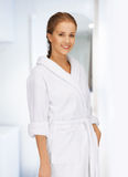 Beautiful woman in white bathrobe Stock Images