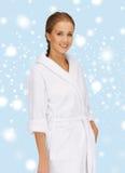 Beautiful woman in white bathrobe Royalty Free Stock Photos