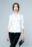 Beautiful woman in white blouse Stock Photography