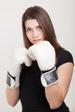 Beautiful woman with white boxing gloves Stock Image