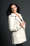 Beautiful woman in white coat Stock Photography