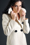 Beautiful woman in white coat Royalty Free Stock Photography