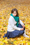 Beautiful woman in white coat and scarf Stock Photos
