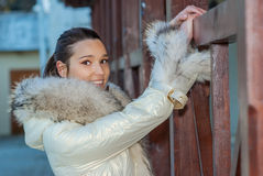 Beautiful woman in a white coat Stock Photos
