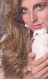 Beautiful woman with white dove Stock Images