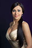 Beautiful woman in a white dress. Beautiful woman in a white satin dress Royalty Free Stock Photography