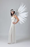 Beautiful woman in white dress with angel wings Royalty Free Stock Images