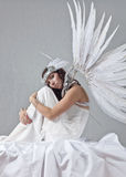 Beautiful woman in white dress with angel wings Royalty Free Stock Image