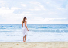 Beautiful woman in a white dress on the beach Royalty Free Stock Photography