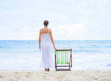 Beautiful woman in a white dress on the beach Stock Image