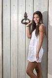 Beautiful woman on a white dress Stock Images