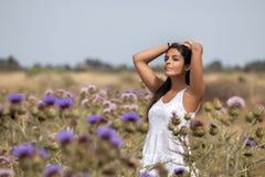 Beautiful woman on a white dress Stock Photo