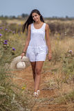 Beautiful woman on a white dress Royalty Free Stock Images