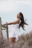 Beautiful woman on a white dress Stock Photography