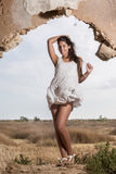 Beautiful woman on a white dress Royalty Free Stock Photography