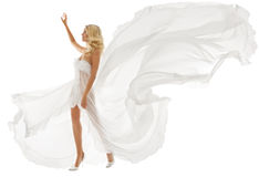 Beautiful woman in white dress with flying fabric. Beautiful woman blonde in white dress with flying fabric walking over isolated white background Stock Image