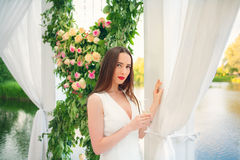 Beautiful woman in white dress Stock Photos