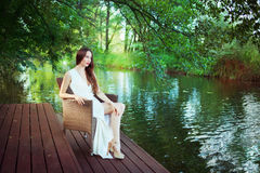 Beautiful woman in white dress Stock Images