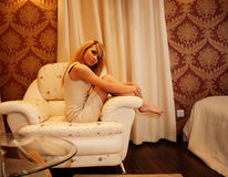 Beautiful woman in white dress l on bed Stock Images