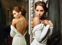 Beautiful woman in white dress with naked back. Stock Photo