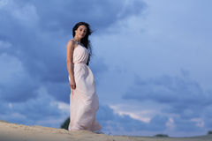 Beautiful woman in a white dress Stock Photos