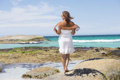 Beautiful woman white dress turquoise ocean Royalty Free Stock Photography