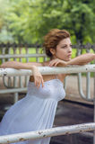 Beautiful woman in white dress Stock Image