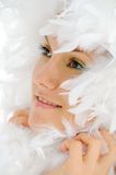 Beautiful woman with white feathers Stock Photos