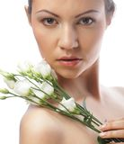 Beautiful woman with white flower Stock Photos