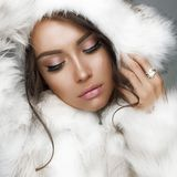 Beautiful woman in white fur coat and fur hat Royalty Free Stock Images