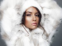 Beautiful woman in white fur coat and fur hat Royalty Free Stock Photography