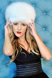 Beautiful woman in white fur hat Royalty Free Stock Photography