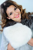 Beautiful woman with white fur muff Royalty Free Stock Image