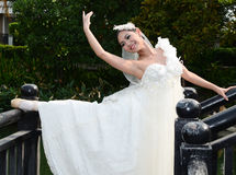 Beautiful woman in white gown of the bride dance stock photo