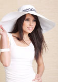 Beautiful woman in white  hat Royalty Free Stock Images