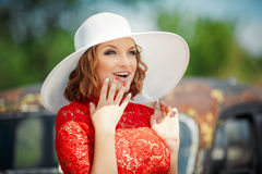 Beautiful woman in white hat expresses the joyful Stock Photos