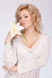 Beautiful woman with white lily Stock Image