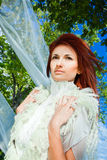 Beautiful woman in white in a park Royalty Free Stock Photography