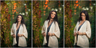Beautiful woman in white posing in autumnal park. Young brunette woman spending time in autumn near a tree in forest Stock Photo