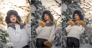 Beautiful woman in white pullover with over-sized fur cap enjoying the winter scenery in forest. Blonde girl posing. Under snow-covered trees branches Stock Photography