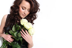 Beautiful woman with white roses Stock Photos