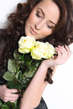 Beautiful woman with white roses Stock Images