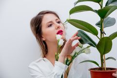 Beautiful woman with white roses in sleeves with plant. Springtime concept or Valentines Day holiday royalty free stock images