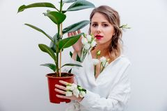 Beautiful woman with white roses in sleeves with plant. Springtime concept or Valentines Day holiday stock photography