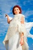 Beautiful woman  in white on seacoast Stock Photo