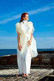 Beautiful woman  in white on seacoast Royalty Free Stock Photos