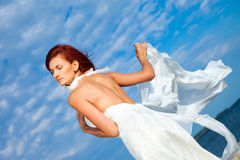 Beautiful woman  in white on seacoast Stock Images