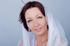 A beautiful woman in a white shawl Royalty Free Stock Photo