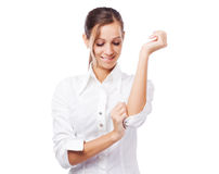 Beautiful woman in white shirt turning up sleeves Stock Photos